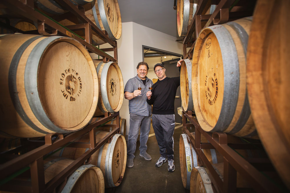 Unusual Duo Toasts to Success in Distilling Business